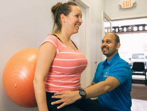 chiropractor check poor posture to a client | Clayton Heights 188 St Physiotherapy and Sport Injury Clinic